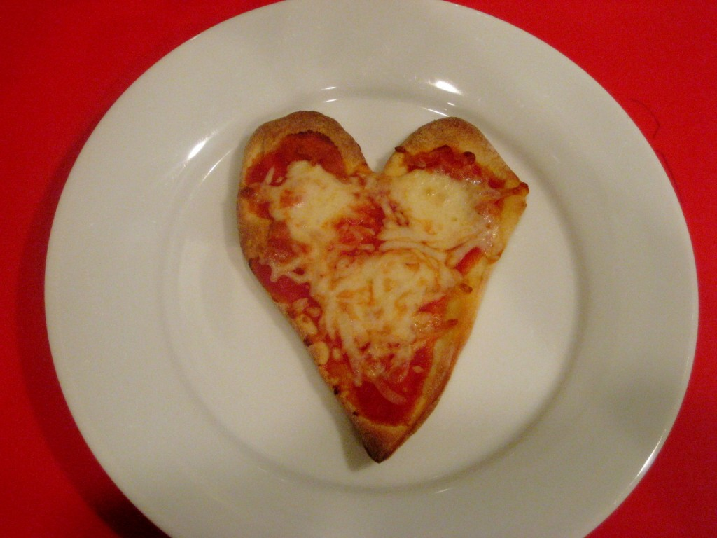 Heart shaped cheese pizza
